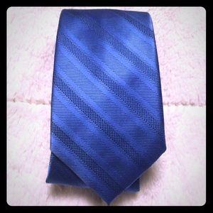Solid blue striped tie